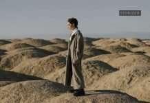 woman standing in a desert
