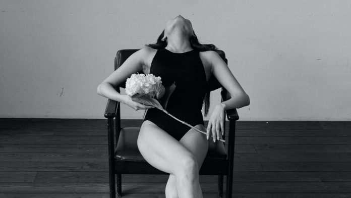 woman-sitting-in-an-erotic-pose